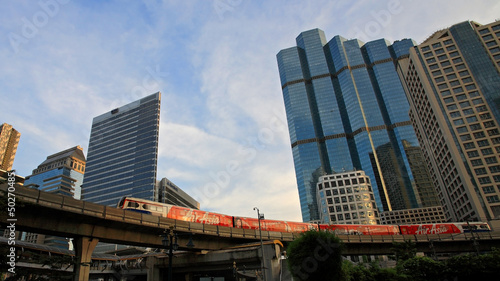 BTS skytrain runs through Sathorn business center in Bangkok
