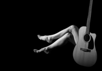 Classic Black and White Art of Woman's body with Guitar
