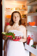 pregnant woman with fresh vegetables
