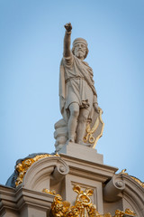 Statue on top of a building in the Grand Place, Brussels