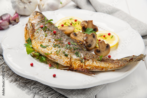Roasted fish with lemon, mushrooms and herbs - 50272492
