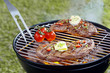 Tender steak grilling on a barbecue