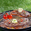 Delicious steak grilling on a barbecue