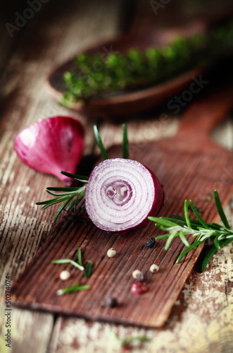 Sliced half red onion and herbs