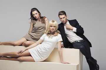 Adorable women in company of a handsome guy