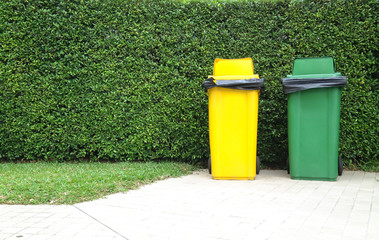 Different Colored Bins Green and yellow waste container