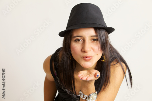 Attractive woman blowing a kiss at the camera
