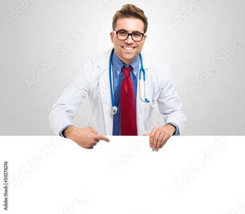 Doctor showing a white board