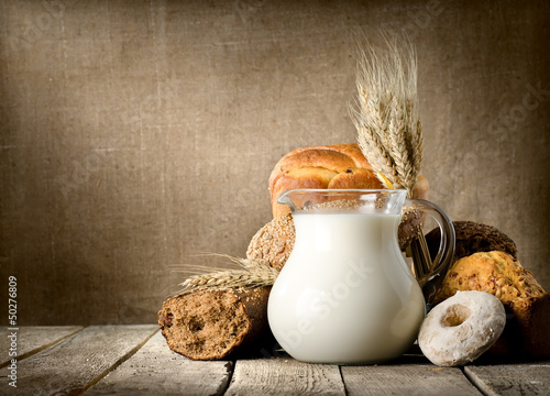 Leinwandbild Motiv Milk and bread on canvas