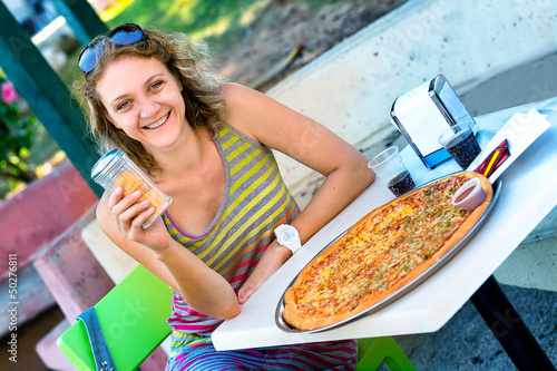 Young woman and pizza