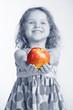 Little girl holding an apple