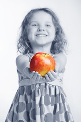 Little girl holding an apple