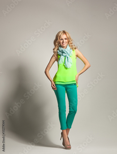 Smiling woman with curly hair presenting spring collection