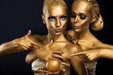 Masquerade. Two Glossy Women with Golden Body Art. Glamor
