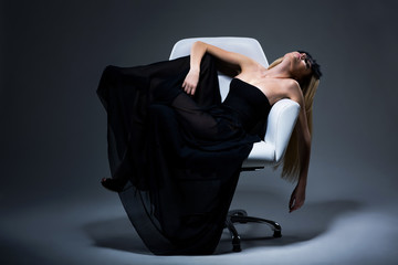 Harmony & Sensuality. Romantic Blond in Black Dress resting