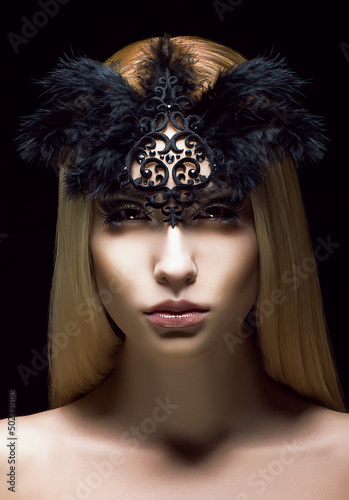 Genuine Woman in Black Mask with Feathers. Aristocratic Face