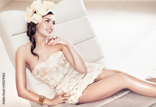 Sexy brunette lady with flower hat