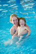 Woman and child in resort swimming pool