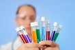 Medical multicolor test tubes with fluid sample in doctor hands