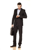 businessman looking at his watch with a laptop bag