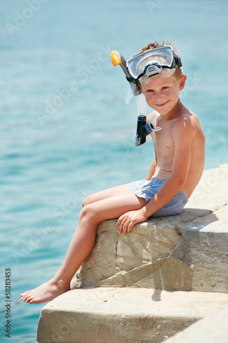 smiling boy with snorkeling gear