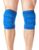 Knee pads to protect the games on male legs. On a white backgrou