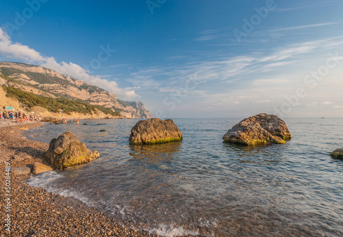 Beach between rocks and sea. Black Sea, Ukraine.