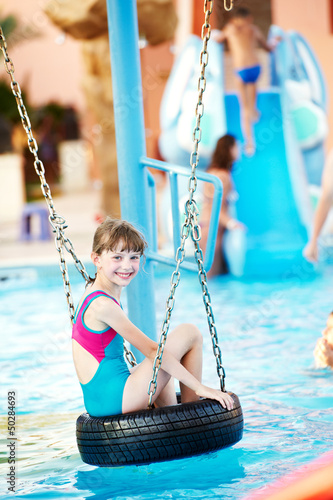 Smiling child in resort swimming pool