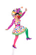 Funny girl clown with a big colorful wig dancing