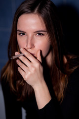 Young woman smoking a joint