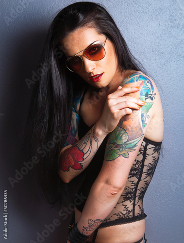 Young beautiful sexy brunette with gorgeous tattoo on her arms