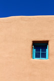 Blue window on adobe wall