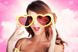Love Is Blind. Woman Wearing Heart Shape Glasses