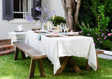 Farmstyle rustic table setting for outdoor garden party