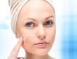 Beautiful woman applying moisturize cream.