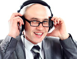 Businessman wearing earphone struggling to hear