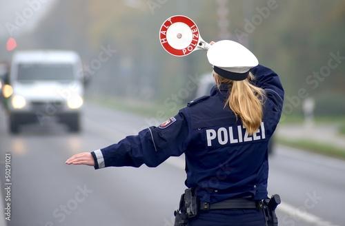 Leinwanddruck Bild Polizei bei Geschwindigkeitskontrolle