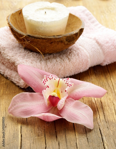 spa concept - pink orchid on a wooden background