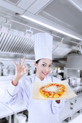 Beautiful chef and delicious pizza