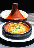 Morocco national dish - tajine of meet with eggs and vegetables