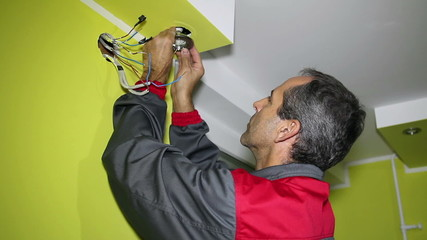 Man Installing Ceiling Led Light
