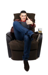 Man with pad, whiskey and thumb up