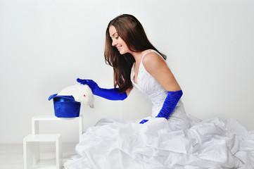 Bride in blue gloves with rabbit
