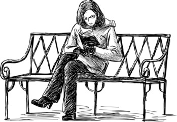 girl reading the book on a bench