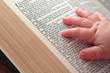 Baby Hand on Open Bible