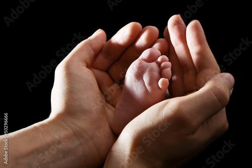 Hands Holding Baby Foot