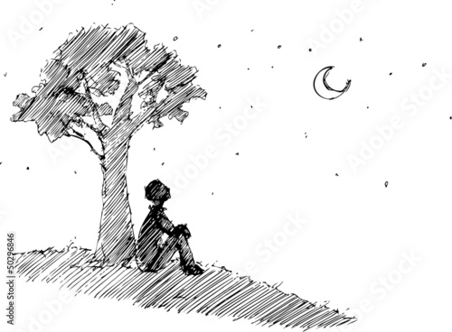 Man looking at the moon under a the tree