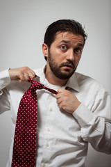 Young bearded man with red tie