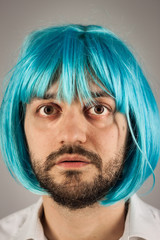Funny bearded man with a blue wig