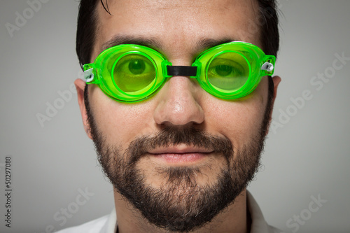 Portrait of a young bearded man with swimming glasses